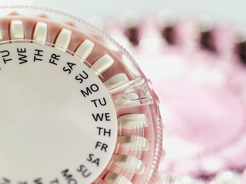 Why do certain hormonal contraceptives increase the risk of HIV