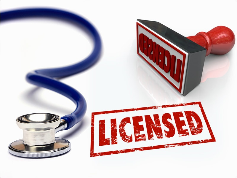 "photo of a stethoscope and stamp with the word ""licensed"""